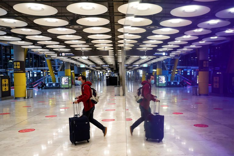 A passenger walks through the Barajas airport in Madrid on February 3.