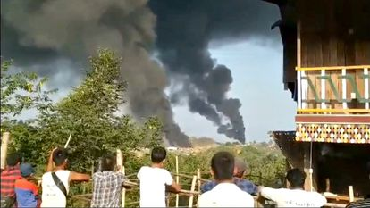 Several people observe columns of smoke in Hkamti, in the Burmese region of Sagaing, in an image released this Saturday on social networks.