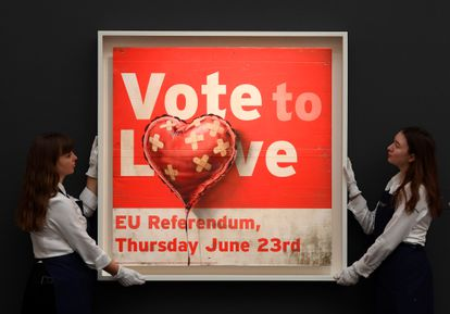 Banksy's 'Vote to Love' during Sotheby's London auction in February 2020.