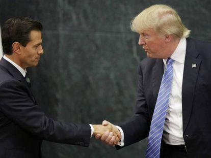 Enrique Peña Nieto and Donald Trump shaking hands in Mexico.