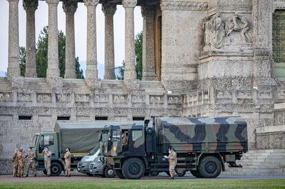 Italian military trucks and soldiers are seen by Bergamo's cemetery after the army were deployed to move coffins from the cemetery to neighbouring provinces, after the cemetery was overwhelmed by the scale of the coronavirus disease (COVID-19) outbreak, in Bergamo, Italy, March 18, 2020. Picture taken March 18, 2020. Sergio Agazzi.Fotogramma via REUTERS ATTENTION EDITORS - ITALY OUT. NO COMMERCIAL OR EDITORIAL SALES IN ITALY AND .IT WEBSITES. THIS IMAGE HAS BEEN SUPPLIED BY A THIRD PARTY. MANDATORY CREDIT.