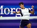 Carlos Alcaraz, of Spain, returns to Felix Auger-Aliassime, of Canada, during the quarterfinals of the U.S. Open tennis tournament Tuesday, Sept. 7, 2021, in New York. (AP Photo/Frank Franklin II)