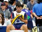 Carlos Alcaraz, of Spain, sits during a break in his match against Peter Gojowczyk, of Germany, during the fourth round of the U.S. Open tennis championships, Sunday, Sept. 5, 2021, in New York. (AP Photo/Frank Franklin II)