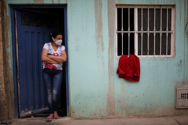 A woman awaits the arrival of social benefits in Bogotá, on April 20, 2020.
