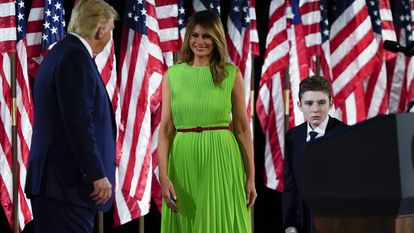 President Donald Trump appears on stage with first lady Melania Trump after he gave a speech from the South Lawn of the White House on the fourth day of the Republican National Convention, Thursday, Aug. 27, 2020, in Washington. Barron Trump is at right. (AP Photo/Alex Brandon)