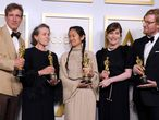 """(From L) Producers Peter Spears, Frances McDormand, Chloe Zhao, Mollye Asher and Dan Janvey, winners of the award for best picture for """"Nomadland,"""" pose in the press room at the Oscars on April 25, 2021, at Union Station in Los Angeles. (Photo by Chris Pizzello / POOL / AFP)"""