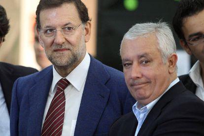 Mariano Rajoy y Javier Arenas, durante un acto celebrado ayer en Córdoba.