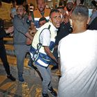 An injured man is carried away as Israeli security forces clash with Palestinian protesters at the al-Aqsa mosque compound in Jerusalem, on May 7, 2021. (Photo by ahmad gharabli / AFP)