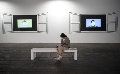A woman sitting in front of works by Alfredo Dufour in the new Senders section, which brings together different Latin American galleries that have not been able to visit the fair due to restrictions.