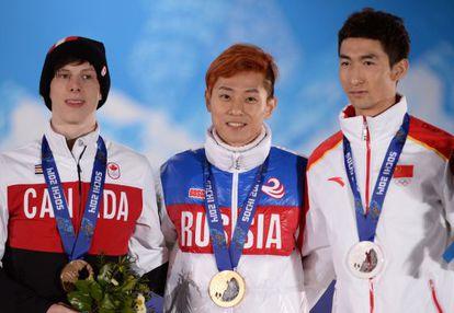 El ruso Victor Ahn, junto a Wu Dajing, plata, y Charle Cournoyer, bronce
