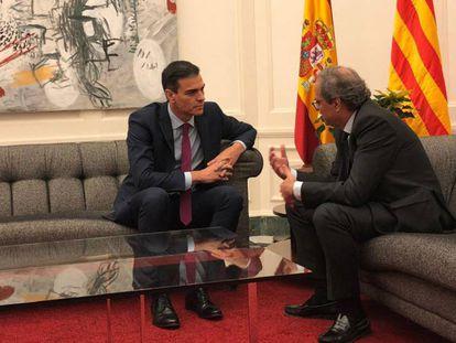 FOTO: Pedro Sánchez y Quim Torra, en una reunión en Barcelona el pasado 21 de diciembre. / VÍDEO: Declaraciones de Carles Puigdemont, este lunes, sobre los Presupuestos.