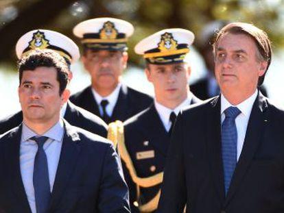 El presidente brasileño aparece junto a su ministro de Justicia en un acto oficial. Hasta la tarde de este martes no se había pronunciado sobre las acusaciones de falta de imparcialidad del exjuez del  caso Lava Jato
