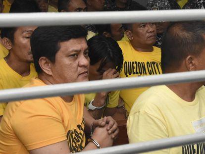 Uno de los condenados por la masacre, Andal Ampatuan Jr., primero por la izquierda, este jueves durante la vista judicial.