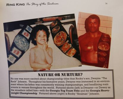 A little Dwayne Johnson next to a photo of his father, Rocky Johnson, in the pages of a wrestling magazine from the 1970s.