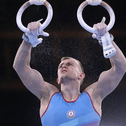 Ivan Tikhonov, of Azerbaijan, performs on the rings during the men's artistic gymnastic qualifications at the 2020 Summer Olympics, Saturday, July 24, 2021, in Tokyo. (AP Photo/Gregory Bull)