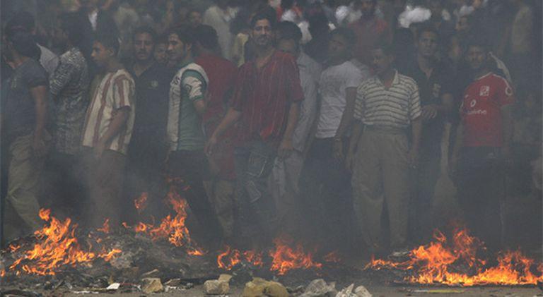 Los criadores egipcios de cerdos se han enfrentado a la policía en protesta por el sacrificio de toda la cabaña del país.