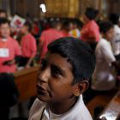 A boy is overcome with emotion after greeting Pope Francis at the cathedral in Morelia