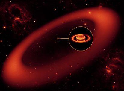 Recreación por ordenador de un nuevo y gigante anillo alrededor de Saturno, localizado por el telescopio espacial <i>Spitzer</i>, de la NASA.