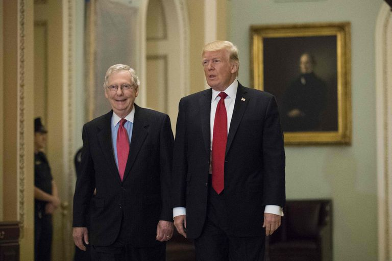 Senate Republican Leader Mitch McConnell alongside former US President Donald Trump in an October 2017 photo.