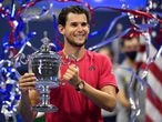 Sep 13 2020; Flushing Meadows, New York, USA; Dominic Thiem of Austria celebrates with the championship trophy after his match against Alexander Zverev of Germany (not pictured) in the men's singles final match on day fourteen of the 2020 U.S. Open tennis tournament at USTA Billie Jean King National Tennis Center. Mandatory Credit: Danielle Parhizkaran-USA TODAY Sports     TPX IMAGES OF THE DAY