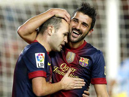 Villa e Iniesta celebran un gol del Barça en 2012