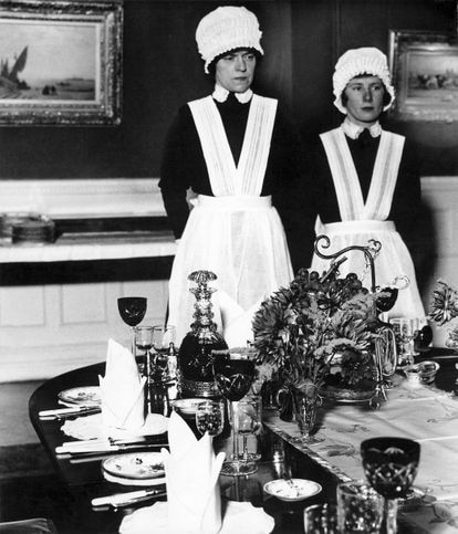 'Maid and second maid prepared to serve dinner', 1936.