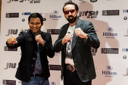 Nicolas Cage and actor Jony Jaa pose during a press conference for the action movie 'Jiu Jitsu' in Nicosia, Cyprus in July 2019.