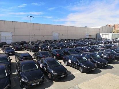Coches de Moove Cars aparcados este martes en su sede de Vallecas, Madrid.