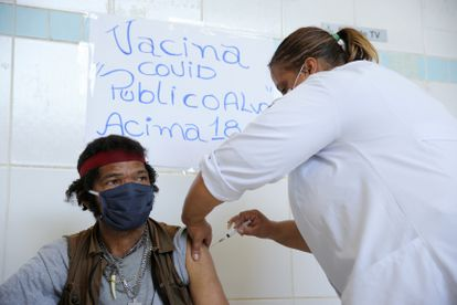 A man receives a dose of the CoronaVac vaccine, in São Paulo, on March 30.