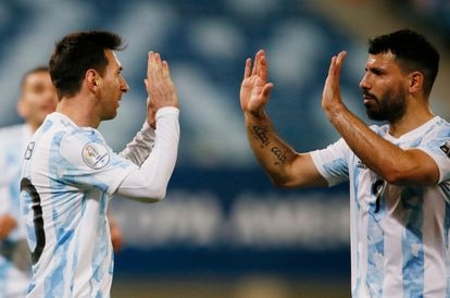 Messi celebrates with Agüero one of his goals against Bolivia.