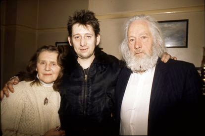 Shane MacGowan, singer of The Pogues, with his mother, Theresa, and father, Maurice, in the family home during Christmas 1997.
