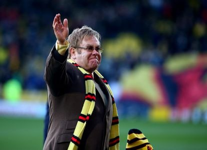 Elton John, now Sir and also Honorary President of Watford FC, attends a match for his team against Wigan Athletic in 2014.