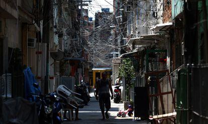A man walks in the Maré favela on October 13, 2020, in Rio de Janeiro, Brazil.