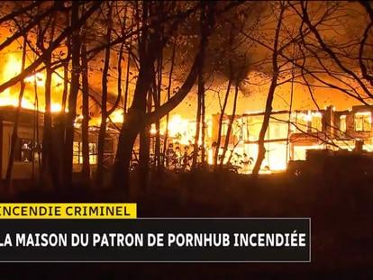 Una imagen de la televisora local que captó el incendio que destruyó la mansión del empresario del porno.