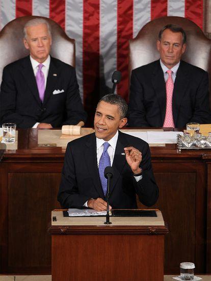 El presidente de EE UU durante su alocución, con Biden (i.) y Boehner de fondo.