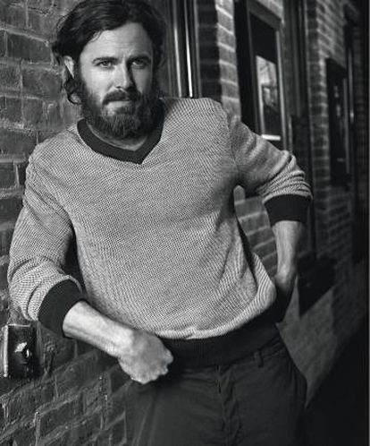Casey Affleck wears Brooks Brothers sweater, Diesel shirt and Valentino pants.