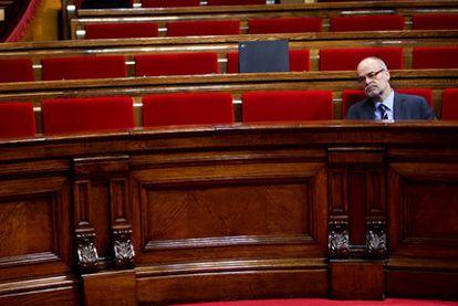 El consejero de Economía de la Generalitat de Cataluña, Antoni Castells, en un pleno del Parlamento catalán.