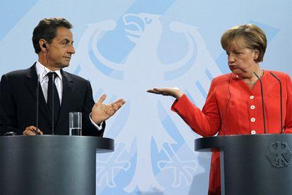 Nicolas Sarkozy y Angela Merkel, en la conferencia de prensa conjunta del pasado 17 de junio.