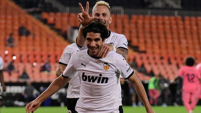Carlos Soler celebrates his third goal against Madrid at Mestalla.