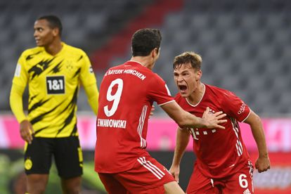 Kimmich celebra con Lewandowski el gol del triunfo del Bayern
