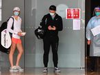 Tennis players leave their hotel for a practice session in Melbourne on January 20, 2021, as some players are allowed to train while serving quarantine for two weeks ahead of the Australian Open tennis tournament. (Photo by William WEST / AFP) / -- IMAGE RESTRICTED TO EDITORIAL USE - STRICTLY NO COMMERCIAL USE --