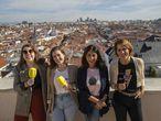 De izquierda a derecha: Carolina Iglesias y Victoria Martín, del podcast 'Estirando el chicle'; Nuria Pérez, del podcast 'Gabinete de curiosidades'; y Laura Baena, del podcast 'Malasmadres', en una terraza de los estudios de Podium Podcast, en la cadena Ser en Madrid.