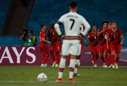 Belgium players celebrate their goal under the gaze of Cristiano Ronaldo.