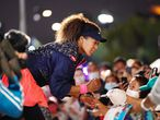 """This hand out photo released by the Tennis Australia on February 20, 2021 shows Japan's Naomi Osaka gives autographs to her fans after winning her women's singles final match against Jennifer Brady of the US on day thirteen of the Australian Open tennis tournament in Melbourne. (Photo by MICHAEL DODGE / TENNIS AUSTRALIA / AFP) / XGTY / -----EDITORS NOTE --- RESTRICTED TO EDITORIAL USE - MANDATORY CREDIT """"AFP PHOTO /MICHAEL DODGE / TENNIS AUSTRALIA """" - NO MARKETING - NO ADVERTISING CAMPAIGNS - DISTRIBUTED AS A SERVICE TO CLIENTS"""