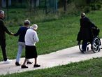 Alzheimer's patients walk at the Village Landais Alzheimer site in Dax, France, September 24, 2020. Picture taken on September 24, 2020. REUTERS/Gonzalo Fuentes