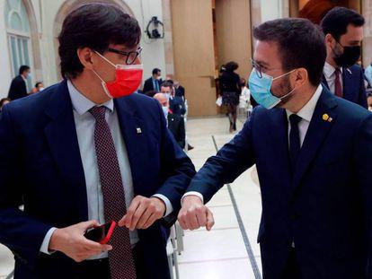 Salvador Illa (izq.) y Pere Aragonès el 12 de marzo durante la sesión constitutiva del Parlament.