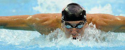 Michael Phelps, ayer en pleno esfuerzo durante las semifinales de los 200 metros mariposa.