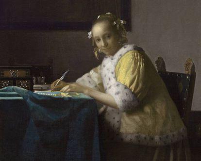 'Mujer de amarillo escribiendo una carta', cuadro de Vermeer de 1665.