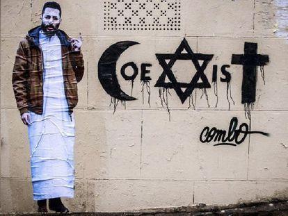 El grafiti de Combo con la palabra 'Coexistir' junto a un autorretrato del artista.