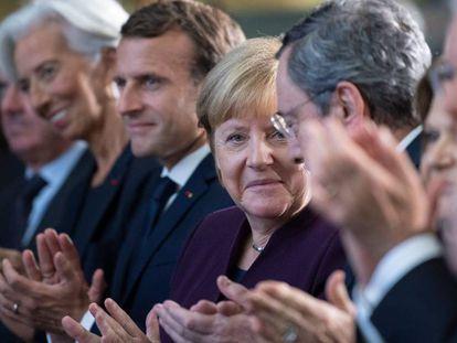De izquierda a derecha, Christine Lagarde, Emmanuel Macron, Angela Merkel y Mario Draghi, en el homenaje a este celebrado el lunes en Fráncfort en su despedida del Banco Central Europeo.